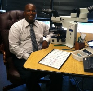 Dr Gates at the Microscope Desk Interpreting Diagnostic Pathology